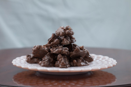 Homemade Christmas crack candy on a pink serving plate