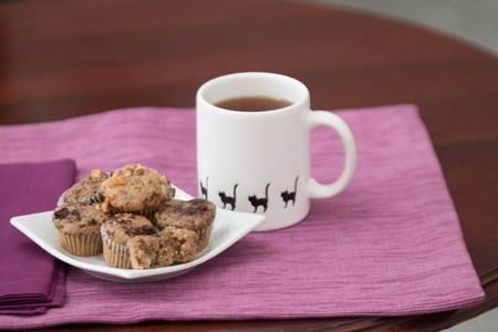 Chocolate chip banana bread mini-muffins with hot tea Banco de Imagens