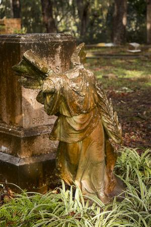 headless angel statute in graveyard Stock Photo