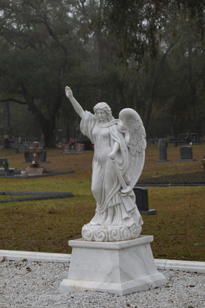 Angel statute in salute in cemetery Stock Photo