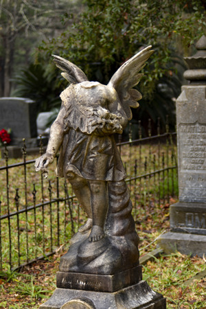 Headless angel sepulchral monument in cemetery