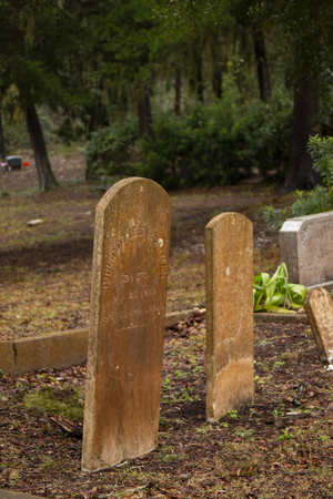 Old classic upright headstones in graveyard
