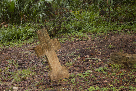 Old weathered unmarked cross tombstone