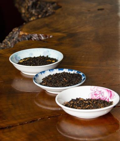 Flight of black tea in small bowls