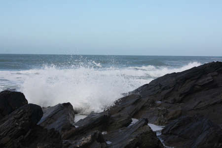 Crashing waves against rocks in Newquay photo