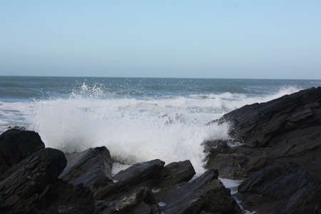 Waves Crashing against rocks in Newquay  photo