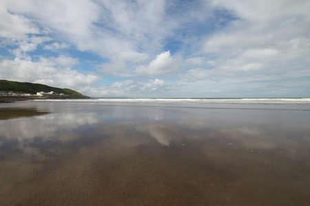 White clouds and blue sky over Westward Ho beach photo