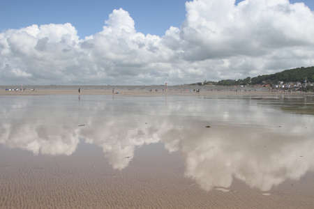 Cumulus clouds over the seaside photo