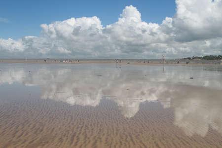 Clouds drifting over Westward Ho beach in Devon photo