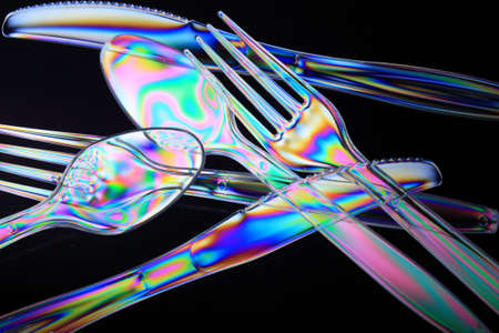 polarization: Rainbow coloured Plastic utensils caused by cross polarization