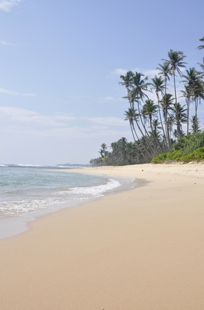 A bright sunny day at the beach at Polhena, Sri Lanka photo