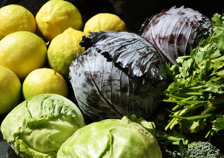 Green Cabbage, Red Cabbage, Lime and other fresh vegetables in the kitchen photo