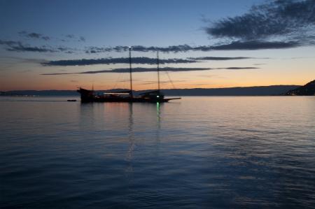 vevey: A Boat Sailing in Lake Geneva at Sunset