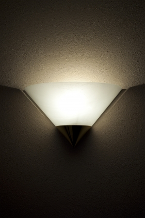 wall mounted: A Wall Mounted Light on a Textured Wall