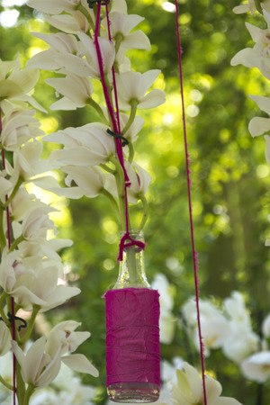 soulful: Beautiful Wedding Theme Arrangement of White Orchids in Bottles