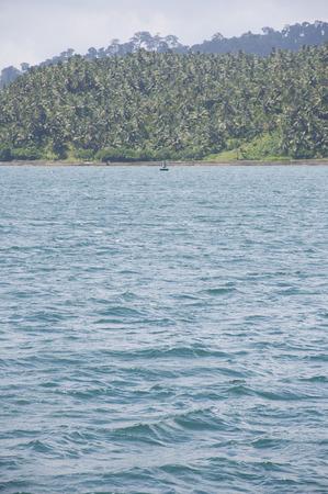 andaman sea: A Boat Sailing in the Andaman Sea