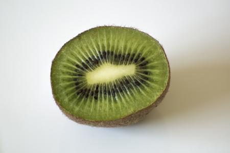Kiwi halves displayed on a white platter