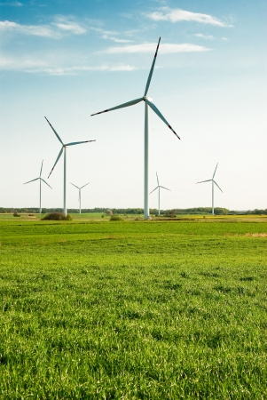 Wind turbines green field Stock Photo