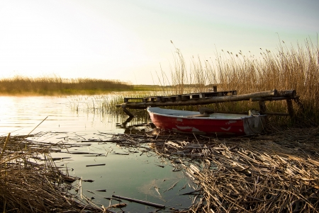 Fishing boat sunset lake Stock Photo