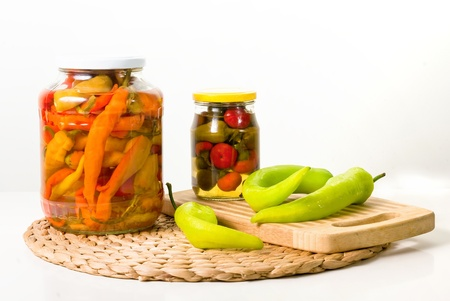 Two jars of canned vegetables with fresh paprika