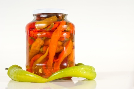 One jar of paprika with fresh vegetables