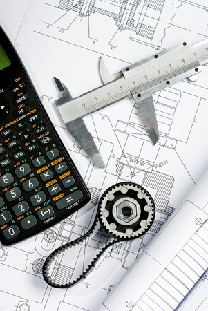 caliper  with calculator on blueprint Stock Photo