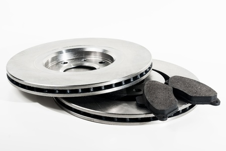 Two brake discs and brake pads isolated on white  Stock Photo