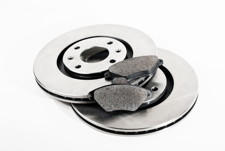 discs: Two brake discs and brake pads isolated on white  Stock Photo