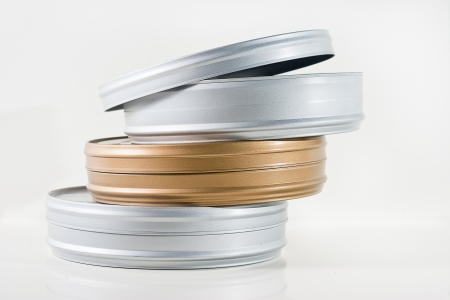 Three 35mm film tins isolated