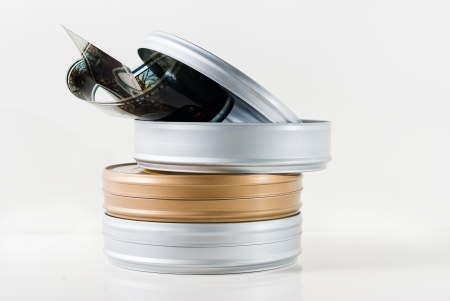 Three 35mm film tins with reel isolated Stock Photo