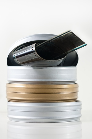 Three old fashioned 35mm film tins isolated