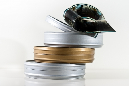 Three 35mm film cans isolated