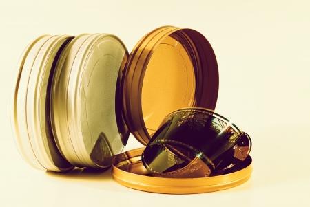 Three 35mm film tins cross processed Stock Photo