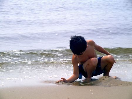 Child on Beach Stock Photo