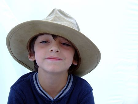 Child in Cowboy hat happy
