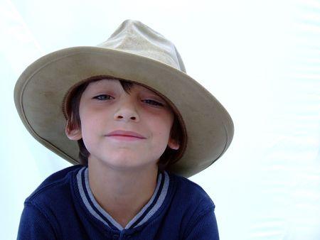 Child in Cowboy hat happy