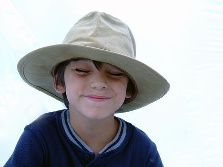 Child in Cowboy hat squinting Stock Photo