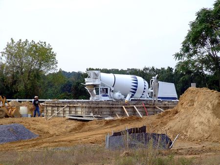 Concrete truck pouring foundation for new home construction  Stock Photo