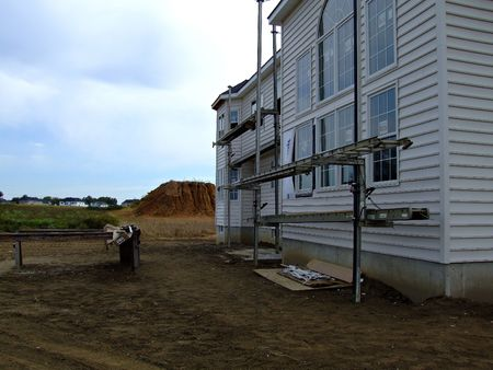 Construction site setup with scaffolding for siding Stock Photo