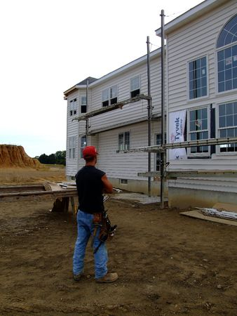 Construction worker at new home site