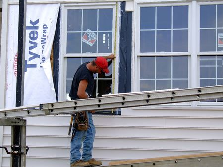 Construction worker measuring window Stock Photo