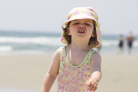 Girl marching on beach Stock Photo