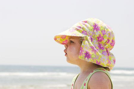 Girl staring off into distance at beach