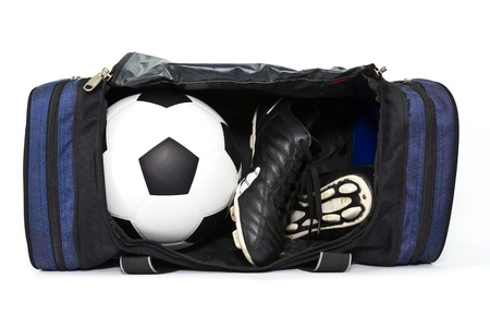 football and soccer shoe in a sport bag on white background Фото со стока