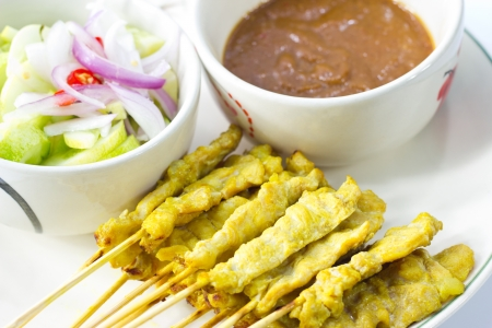 red onion: Satay thai food ,pork grill with peanut sauce and cucumber soup red onion