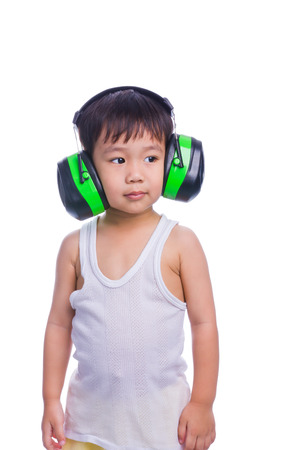 asian boy in a white singlet wearing earmuffs isolated on white background photo