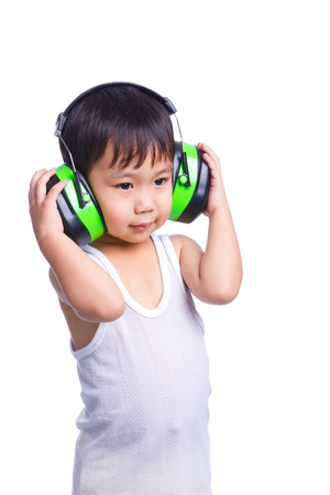 asian boy in a white singlet wearing earmuffs isolated on white background
