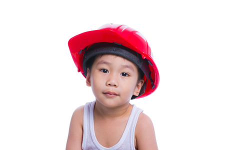 white singlet: asian boy in a white singlet wearing red hard hat isolated on white background Stock Photo