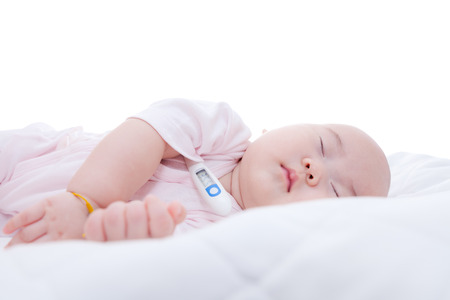 Close-up newborn baby sleeping with digital mercury thermometer photo