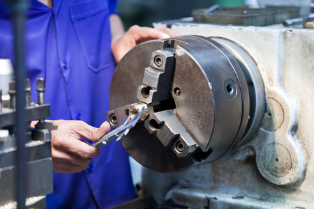 maintenance man: Milling machine operator working in factory workshop